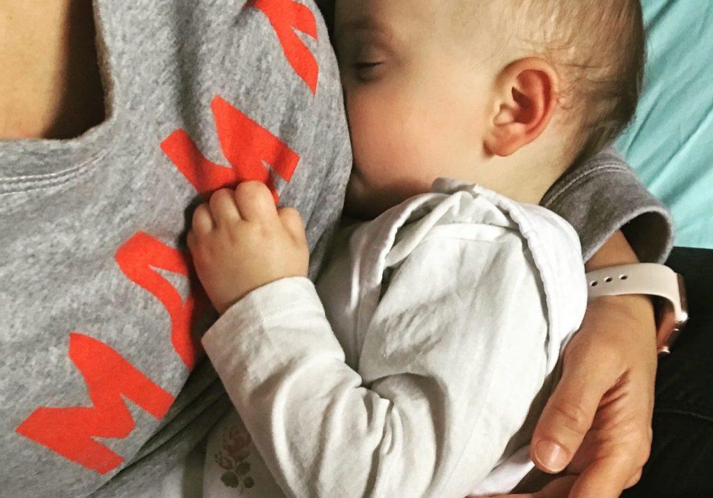 Breast feeding baby the New Parent Company